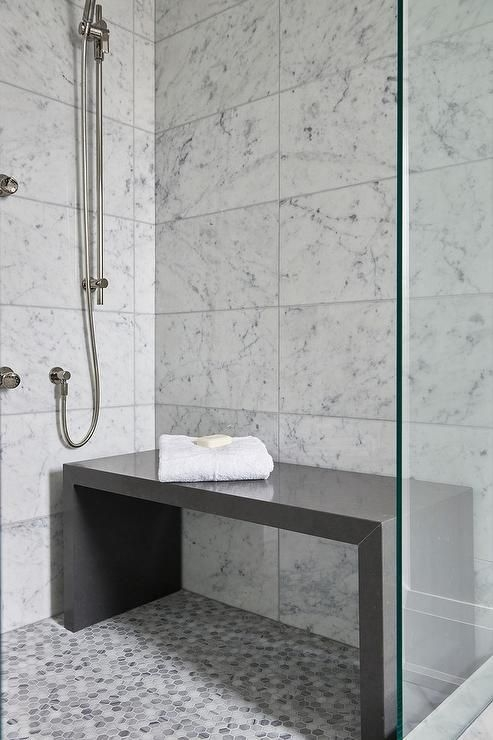 Contemporary Bathroom Shower Is Filled With White Grid Marble Tiles Lined With A Freestanding