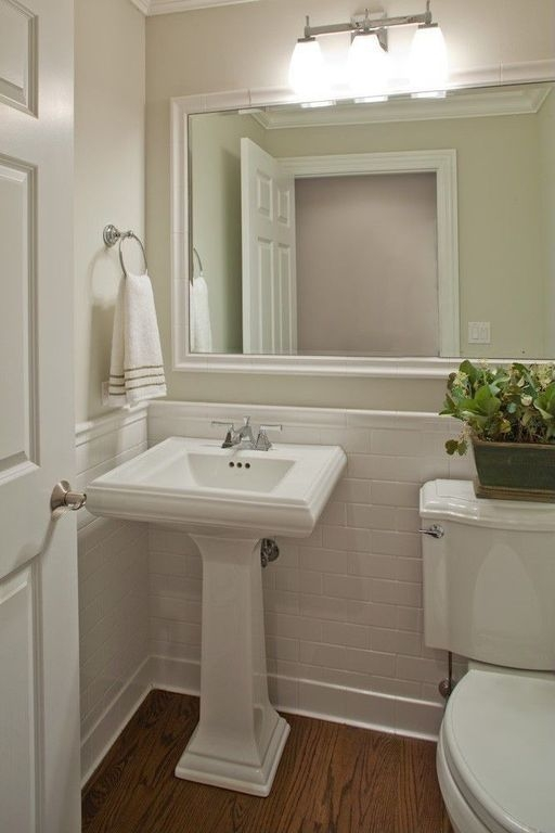 Traditional Powder Room With Oak Hardwood Floor Kichler Lighting Uptown 3 Light Bathroom Light